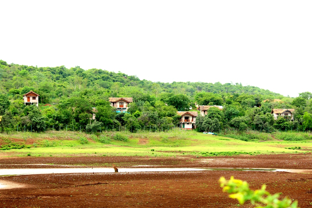 Cottages and the dried-up vilaspur lake