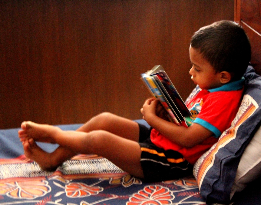 Busy reading a book by himself