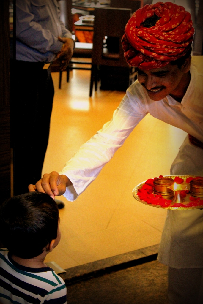 Welcoming guests with a tilak