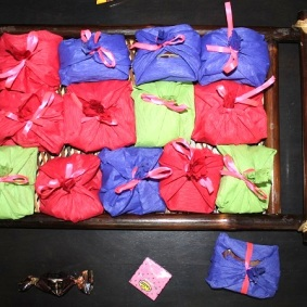 Candies wrapped in tissue paper and tied with Ribbon